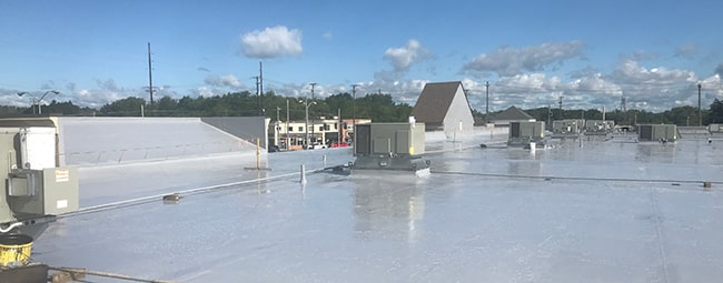 silicone-roof-coating-on-a-commercial-roof-denver